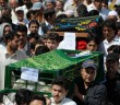 Pakistani Shiite Muslims carry coffins o