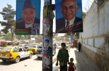 Posters of incumbent Hamid Karzai and opposition candidate Ashraf Ghani hang from a lamp post. Ghani is Karzai's primary ethnic Pashtun rival in the 20 August election.
