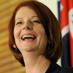 Australia appointed its first woman prime minister, Julia Gillard, who vowed on Thursday to end division over a controversial mining tax, resurrect a carbon trade scheme and call elections within months.