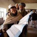 A Pashtun man looks up his desired candidate on the ballot as he queues to vote in Kabul. Saurabh Das / AP