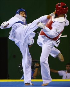 Afghanistan's Rohullah Nikpai (L) in action at the Beijing Olympics