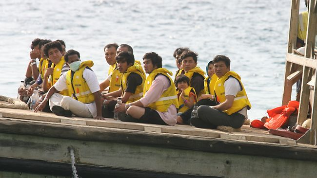 Dreaming of freedom: A boatload of refugees arrive in Australian waters. Picture: Colin Murty Source: Herald Sun