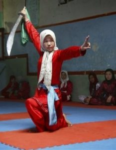 A Hazara girl practices the martial arts with a sword at a Wosho training club in Injil, Herat province west of Kabul, Afghanistan on Wednesday, April 6, 2011. (AP Photo)
