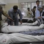 Pakistani Shiite Muslim mourners place t