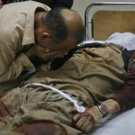 An ethnic Hazara Shi'ite man cries over the body of his brother killed in a shootout by unidentified gunmen in Quetta