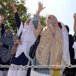 Pakistani Shiite Muslim students shout s