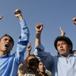 Ethnic Hazara Shi'ite men chant slogans during a demonstration outside hospital in Quetta