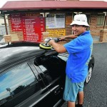 NEW LIFE: Ali Ramazani puts the finishing touches on a client's car. Picture: Les Smith