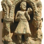 Kushan devotee in the traditional costume with tunic and boots, 2nd century, Gandhara