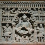 Maitreya, with Kushan devotees, left and right, 2nd century Gandhara