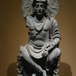 Maitreya, with Kushan devotee couple. 2nd century Gandhara