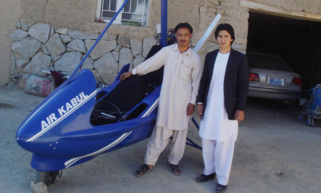 Sabir Shah (left), from the dicey province of Ghazni in Afghanistan, with his homemade microlight. Photograph: Jon Boone for the Guardian