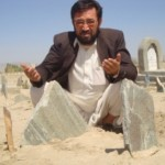 Juma Khan Rezai at his niece's grave in Ghazni. (Photo: Alizada)