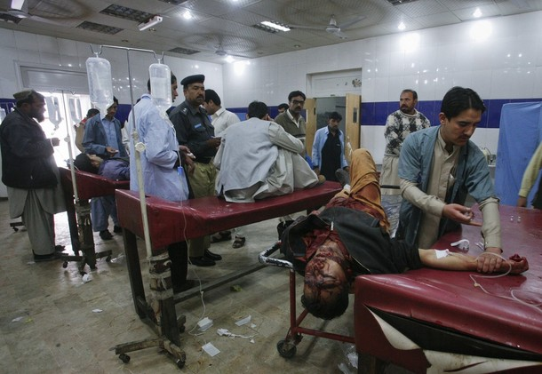Paramedics assist ethnic Hazara men, who were injured in an attack by unidentified gunmen, at a hospital in Quetta