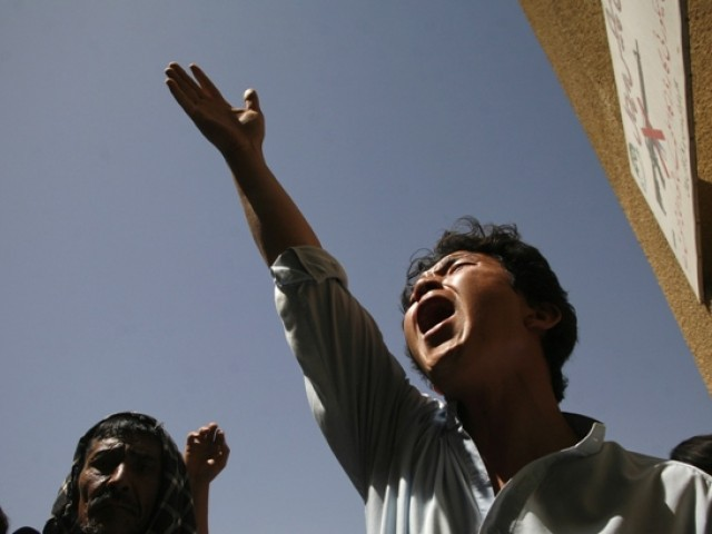 Demonstrators call for religious groups behind sectarian violence to be banned. PHOTO: REUTERS