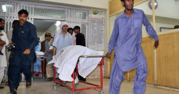 People at civil hospital shifting the bodies of those killed in the suicide blast near the Imambargah in Hazara town on Sunday. – Photo by Online