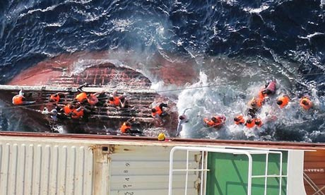 Asylum seekers from Pakistan are rescued by the JPO Vulpecula in 2012 after their boat sank. Photograph: guardian.co.uk