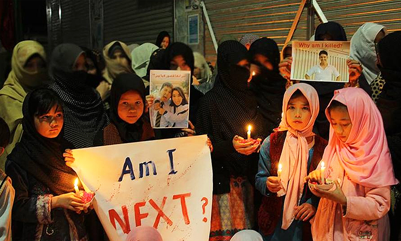 Hazara girls holding candles in memory of victims of the Mastung incident. -Photo by author