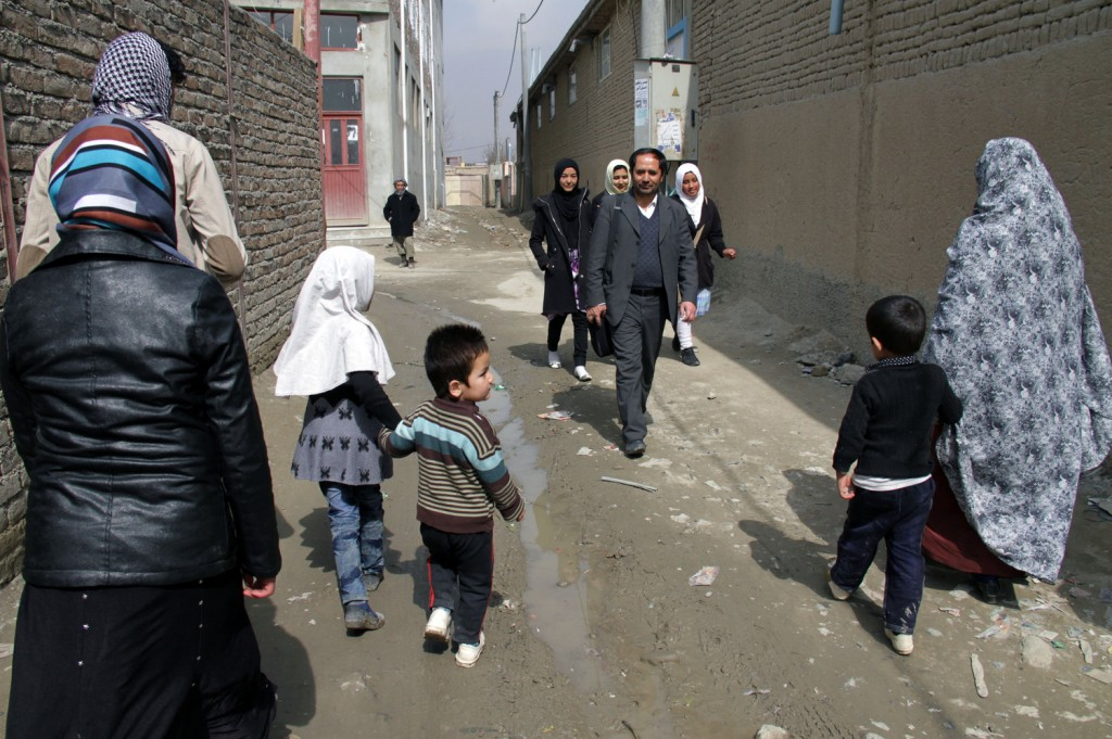 Aziz Royesh (center) in the streets near the Marefat School in Kabul. Zabihullah Tamanna for NPR