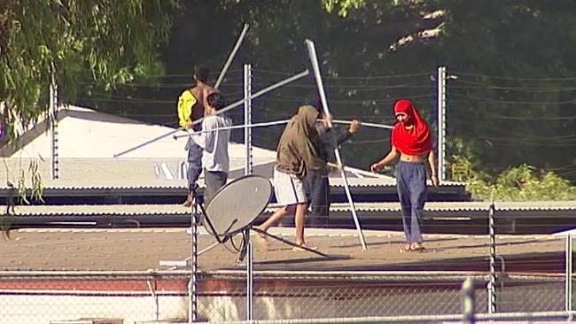 A riot by detainees at Darwin's immigration detention centre yesterday. Source: Supplied