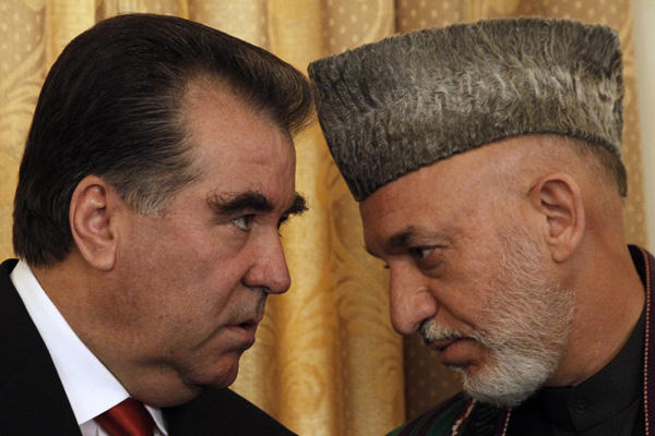 Afghan President Hamid Karzai talks to the President of Tajikistan Emomalii Rahmon in Kabul, Afghanistan, Oct. 25. Karzai told reporters Monday that once or twice a year Iran gives his office $700,000 to $975,000 for official presidential expenses. Allauddin Khan/AP Photo