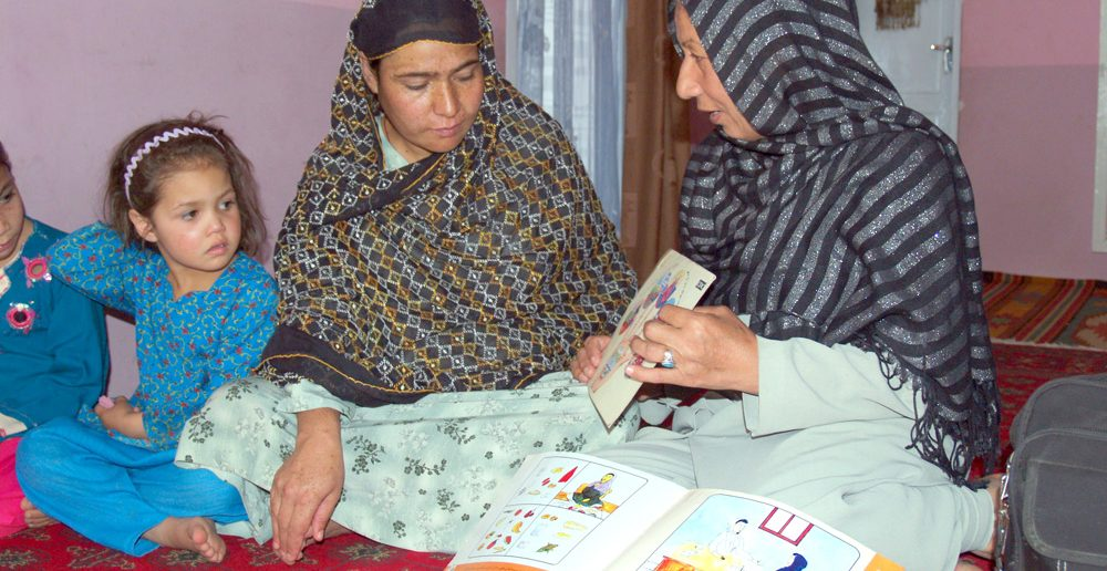 In Afghanistan, CARE Canada's community-based educators visit homes to promote good health. Kieran Green/CARE photo.