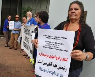 June Mills leads the protest outside the Darwin Magistrates Court. Picture: KATRINA BRIDGEFORD
