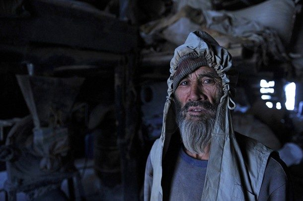 A Hazara day labourer poses for the camera in Kabul's old quarter on June 8, 2011. Hazaras are Turkic people./ Photo by GETTY IMAGES