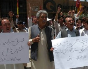 Hazara Democratic Party activists outside the Quetta Press Club May 18 protest the slayings of Hazara Shia community members. About 25 Hazaras have been killed in three different attacks in Quetta in the past two months. [Zia Ur Rehman