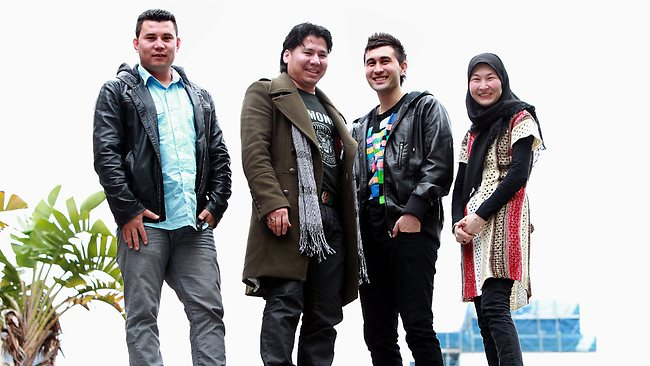 From left, Wahidullah Akbari, Assadullah Nazari, Hussain Ewazi and Zainab Ewazi have vivid memories of their journey on a fishing boat that ended when they were picked up by the Tampa. Picture: Alan Pryke Source: The Australian