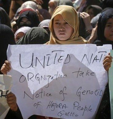 Reuters Pictures: Ethnic Hazara Shi'ite women hold placards during a demonstration in Quetta September 21, 2011 to condemn the shootout by unidentified gunmen, a day earlier. Gunmen opened fire on a bus in Pakistan's southwestern province of Baluchistan in a suspected sectarian attack on Tuesday, killing at least 26 Shi'ite Muslim pilgrims traveling to Iran, police said.