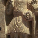 """A Buddhist devotee in Kushan dress, Mathura, 2nd century. The Kushan dress is generally depicted as quite stiff, and it is thought it was often made of leather (Francine Tissot, """"Gandhara"""")."""