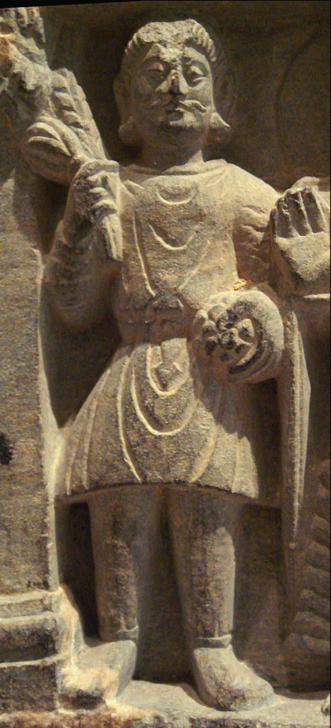 "A Buddhist devotee in Kushan dress, Mathura, 2nd century. The Kushan dress is generally depicted as quite stiff, and it is thought it was often made of leather (Francine Tissot, ""Gandhara"")."