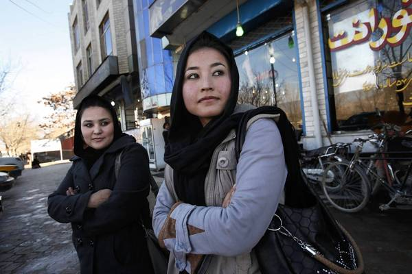In Kabul, 2nd Lt. Sourya Saleh, 20, left, and 2nd Lt. Masooma Hussaini are Hazara air force helicopter pilots who were trained in the United States. (Carolyn Cole / Los Angeles Times / December 28, 2012)
