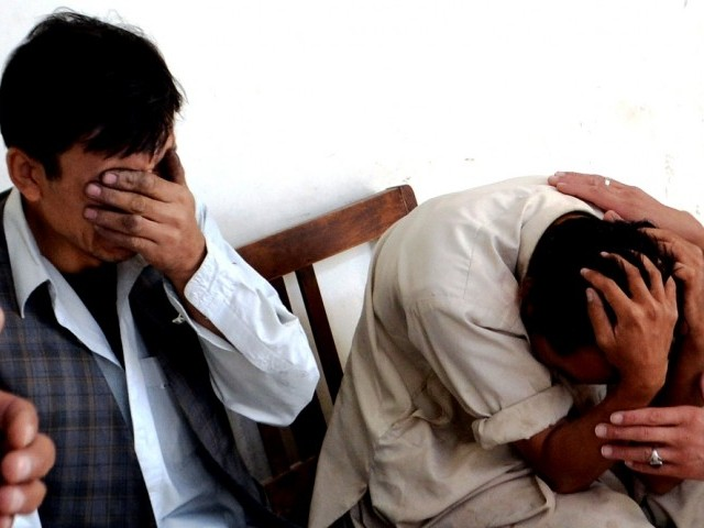 A file photo of mourning members of the Hazara community. PHOTO: AFP/FILE