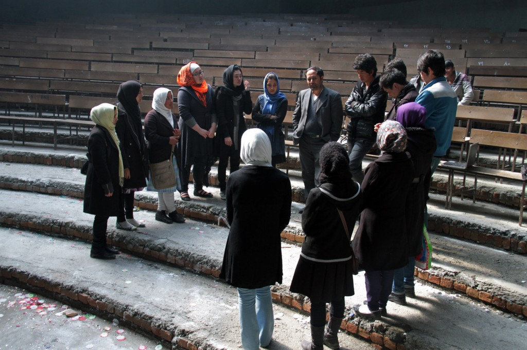 Royesh (center) holds an impromptu class in the auditorium of Marefat School in Kabul. Zabihullah Tamanna for NPR