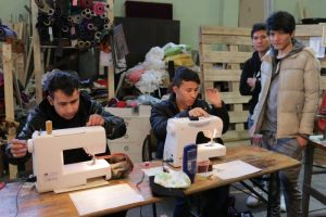 PHOTO: Young Hazara refugees living at Traiskirchen refugee reception centre, south of Vienna, learn trades. (Kim Traill)